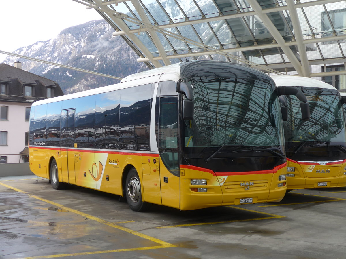 (187'545) - PostAuto Graubünden - GR 162'973 - MAN am 1. Januar 2018 in Chur, Postautostation