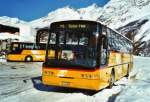 Neoplan/346914/124320---postauto-wallis---vs (124'320) - PostAuto Wallis - VS 243'895 - Neoplan (ex P 25'171) am 14. Februar 2010 in Saas-Fee, Postautostation
